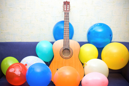 Guitar and colorful balloons