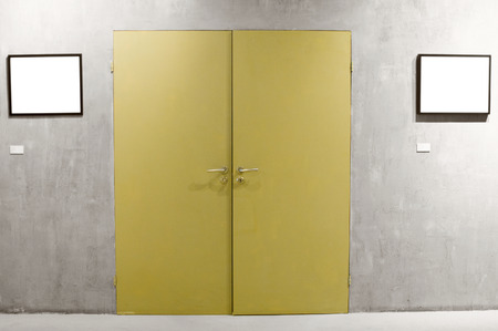 gallerie: Two frames on cement wall and yellow door Stock Photo