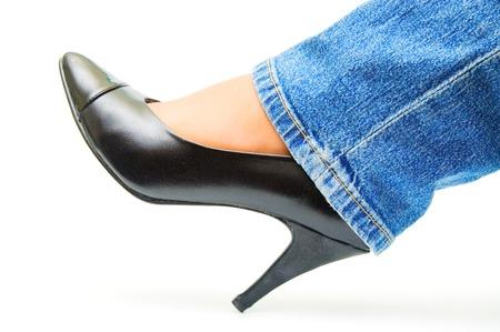 Black shoe on girl`s leg photo