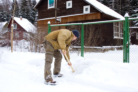 Man shoveling snow photo
