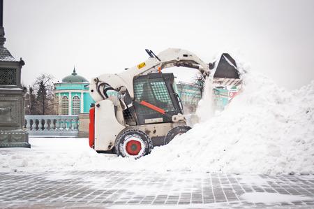 Snowplow removing snow photo