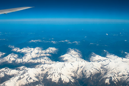 airfoil: View from airliner window with mountain range