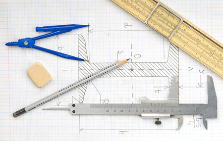 Page with technical drawing and engineering tools   photo