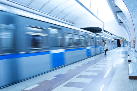 subway platform: Girl standing at subway platform Editorial
