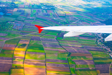 airfoil: Colorful fields under  wing of the plane
