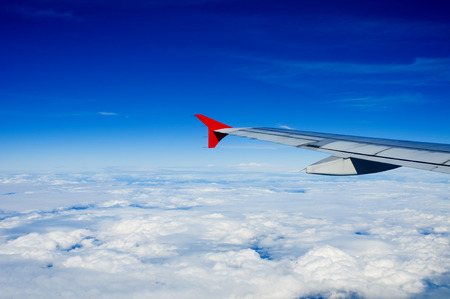 airfoil: View of jet plane wing with clouds Stock Photo