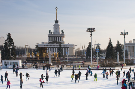 skating rink: MOSCOW, RUSSIA - NOVEMBER 29, 2014: People at Skating rink on VDNKh (All-Russia Exhibition Centre), Moscow, Russia. It  is the largest ice rink in the world