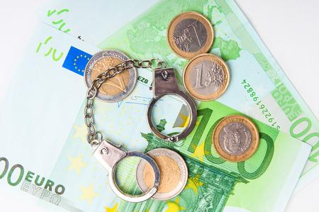 cash money: Dinero en efectivo y las esposas Foto de archivo