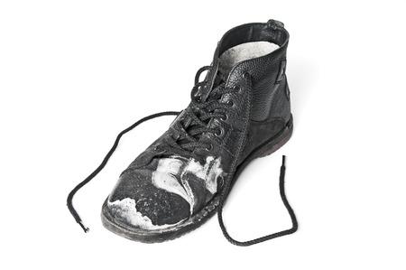 muddy clothes: Single dirty black shoe