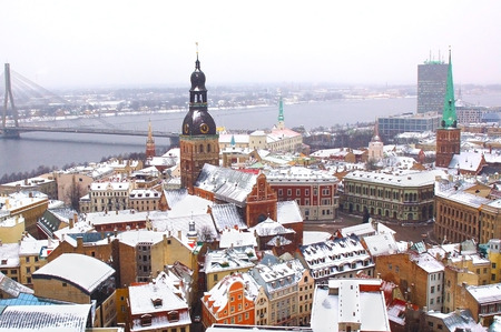cable bridge: Panorama of Riga downtown with big cable bridge over Daugava river