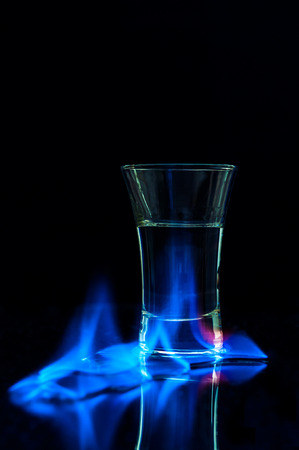 vodka: Flaming vodka on dark backdrop Stock Photo
