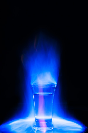 blue flame: Cocktail burning blue flame Stock Photo