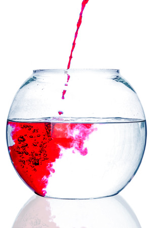 fishbowl: Red water flowing to fishbowl Stock Photo