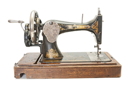 Vintage sewing machine on white background