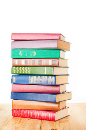 bibliophile: Old colorful books on white background