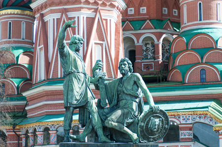 minin: Saint Basil Church and Minin and Pozharsky Monument at Red Square in Moscow Russia