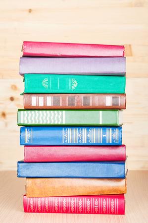 bibliophile: Old books on wooden shelf Stock Photo