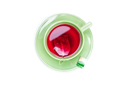 Cup with teabag on white background