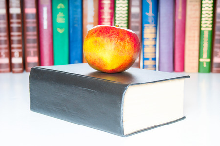 bibliophile: Books with apple on white background Stock Photo
