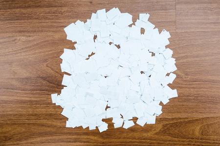 discard: Paper waste on floor