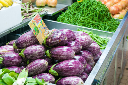 central market: Ripe eggplants on stall at Central Market in Valencia Stock Photo