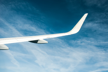 airfoil: Airplane wing and clouds Stock Photo