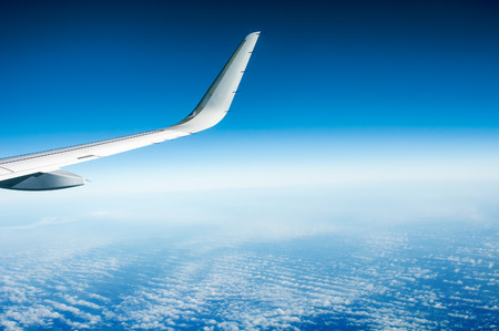airfoil: Wing of  flying  airplane Stock Photo