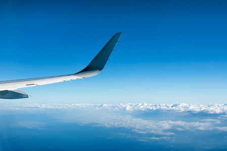 airfoil: Wing of  airplane  flying above the clouds