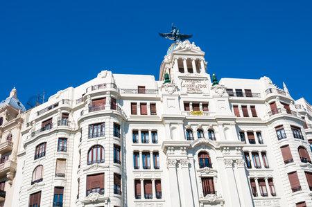 carrer: Antique building at crossroad of carrer de Xativa and avenue Marques de Sotelo in Valencia, Spain