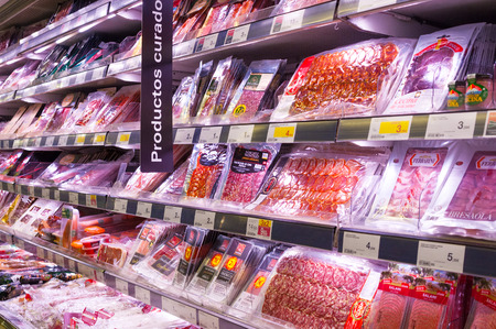 VALENCIA, SPAIN- JULY 04, 2015: Sausage stall in supermarket Mercadona is largest supermarket chain in Spain