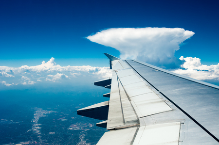 airfoil: Wing of  airplane  flying above the cloud like nuclear mushroom
