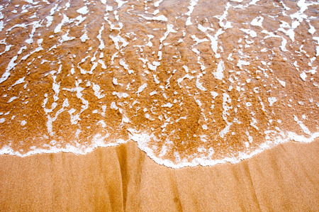 sea wave: Sea wave over sand