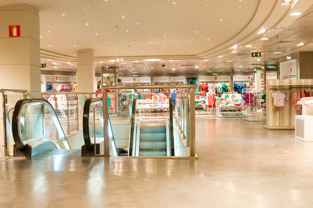 clothing store: VALENCIA, SPAIN - JUNE 29, 2015: Escalator in Sfera clothing store in Valencia, Spain.