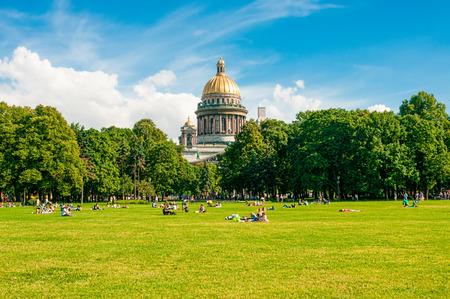 isaac: ST. PETERSBURG, RUSSIA - JULY 26, 2015: People relaxing in a park near St. Isaac Cathedral in St. Petersburg, Russia Editorial