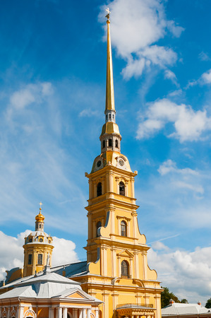 spire: ST. PETERSBURG, RUSSIA - JULY 26, 2015: Spire of Peter and Paul Fortress against blue sky in St. Petersburg, Russia