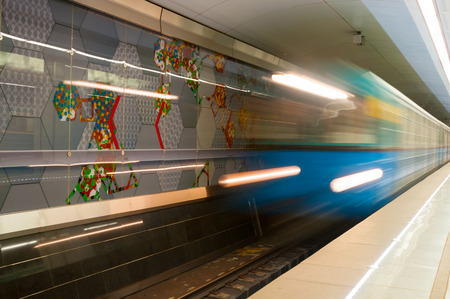 rapid steel: MOSCOW, RUSSIA - OCTOBER 06, 2015: Arriving subway train at metro station Spartak in Moscow, Russia. Spartak was opened  August 27, 2014.