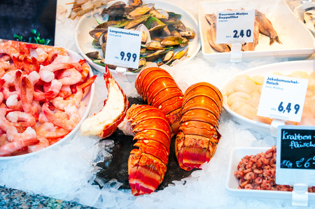 raw lobster: Fresh seafood stall at a market Stock Photo