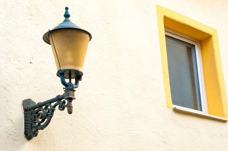 adobe wall: Old lantern on adobe wall