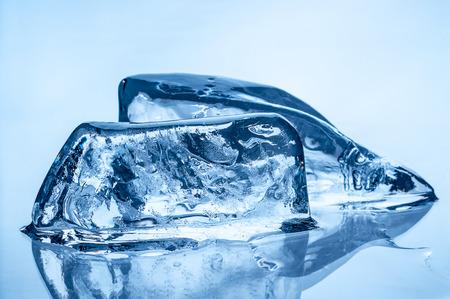 Melting ice on blue background