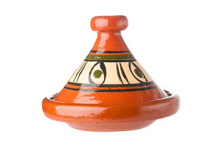 Traditional decorated Moroccan tagine on white background