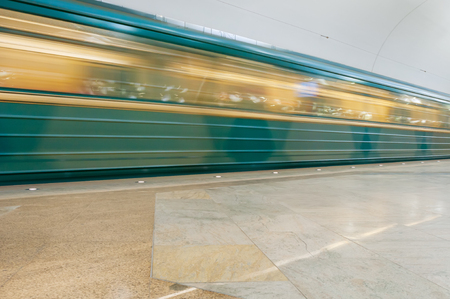 rapid steel: Moving train at metro station Stock Photo