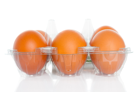 molded: Eggs in molded container on white background Stock Photo