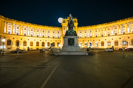 hofburg: VIENNA, AUSTRIA - APRIL 23, 2016: Famous Hofburg Palace and memorial Prinz Eugen in Vienna, Austria at night