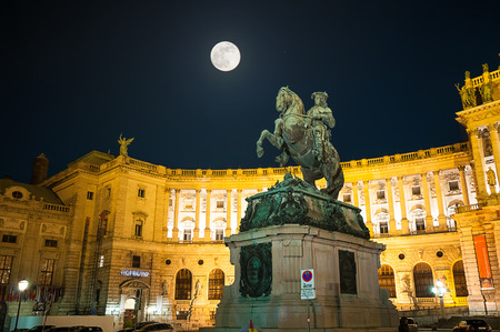 hofburg: VIENNA, AUSTRIA - APRIL 23, 2016: Famous Hofburg Palace and memorial Prinz Eugen in Vienna, Austria in full moon night