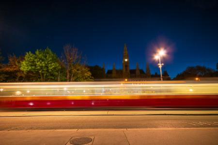blurry lights: Blurry lights tram at night Stock Photo