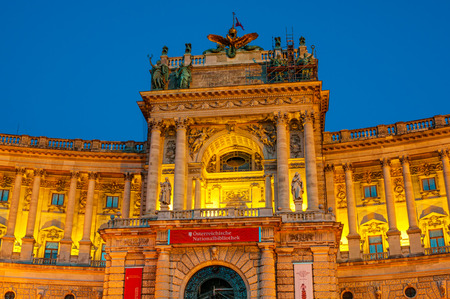congress center: VIENNA, AUSTRIA - APRIL 24, 2016: Austrian National Library and the Hofburg Congress Center on Heldenplatz in Hofburg in evening Editorial