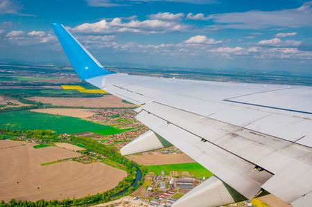 plane window: View from plane window on rural landscape