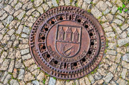 PRAGUE, CZECH REPUBLIC - JUNE 19, 2016: Manhole cover of Prague sewerage