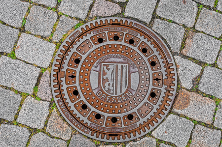 DRESDEN, GERMANY- JUNE 20, 2016: Manhole cover of Dresden sewerage Editorial