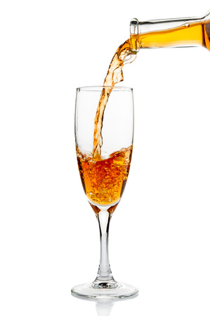 White wine pouring in goblet closeup Stock Photo